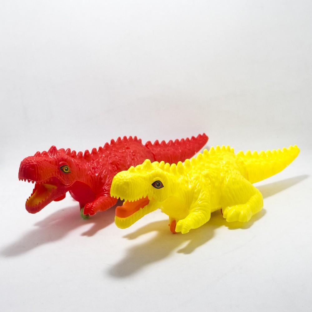 Dinosaurio  a cuerda MED E/Bolsa
